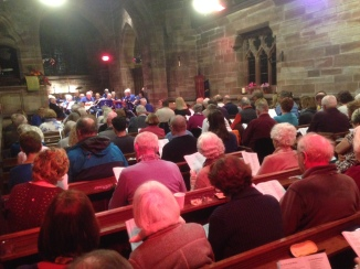 Picture from the back of the church showing the audience watching the concert